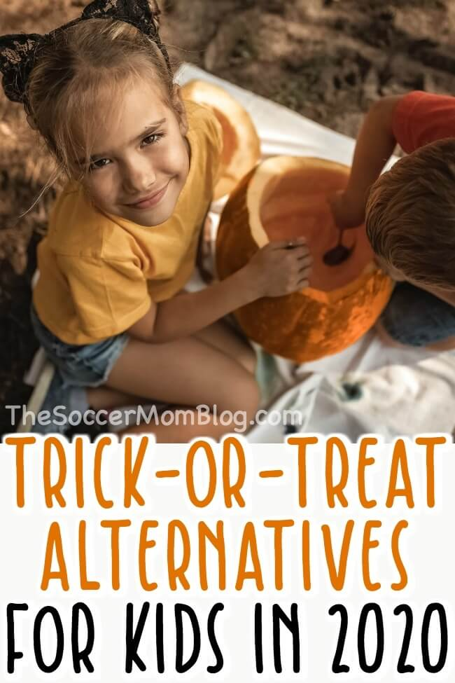 kids carving pumpkins as an alternative to trick-or-treating