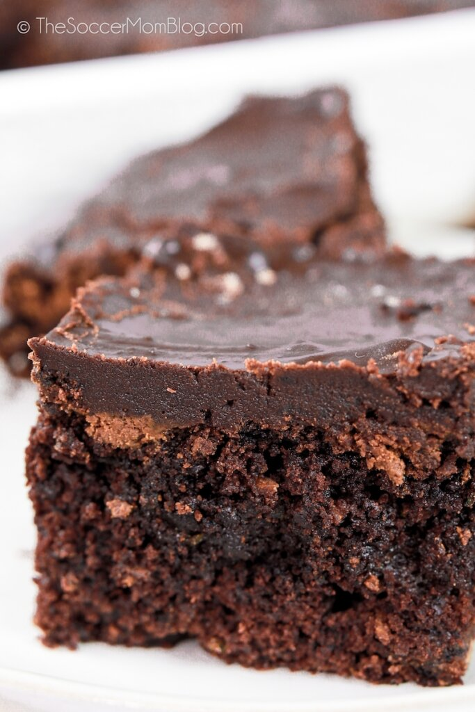 close up of a fudge brownie made with zucchini and chocolate frosting