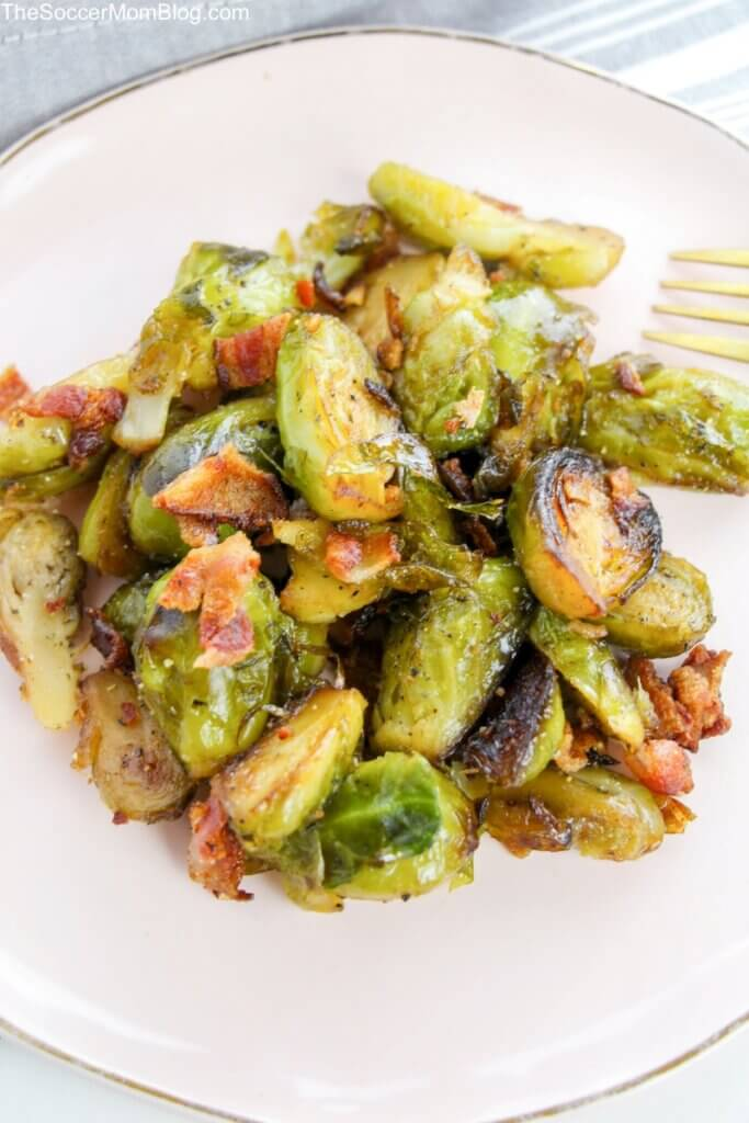 plate of roasted brussels sprouts with bacon and maple syrup