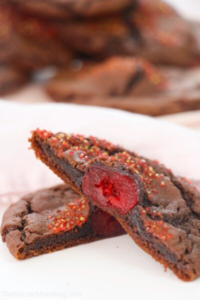 chocolate covered cherry cookies cut in half to show cherry inside