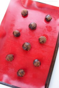 chocolate cherry cookie dough balls on baking sheet