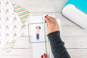 cutting out child's photo with paper cutter