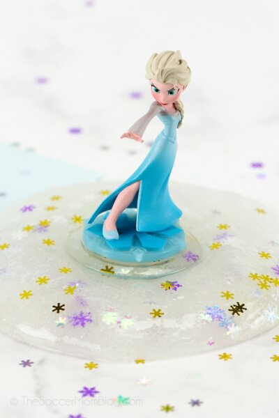 Elsa figurine standing in a puddle of snowflake slime