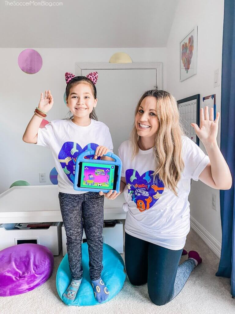 mom and daughter holding tablet with GoNoodle app