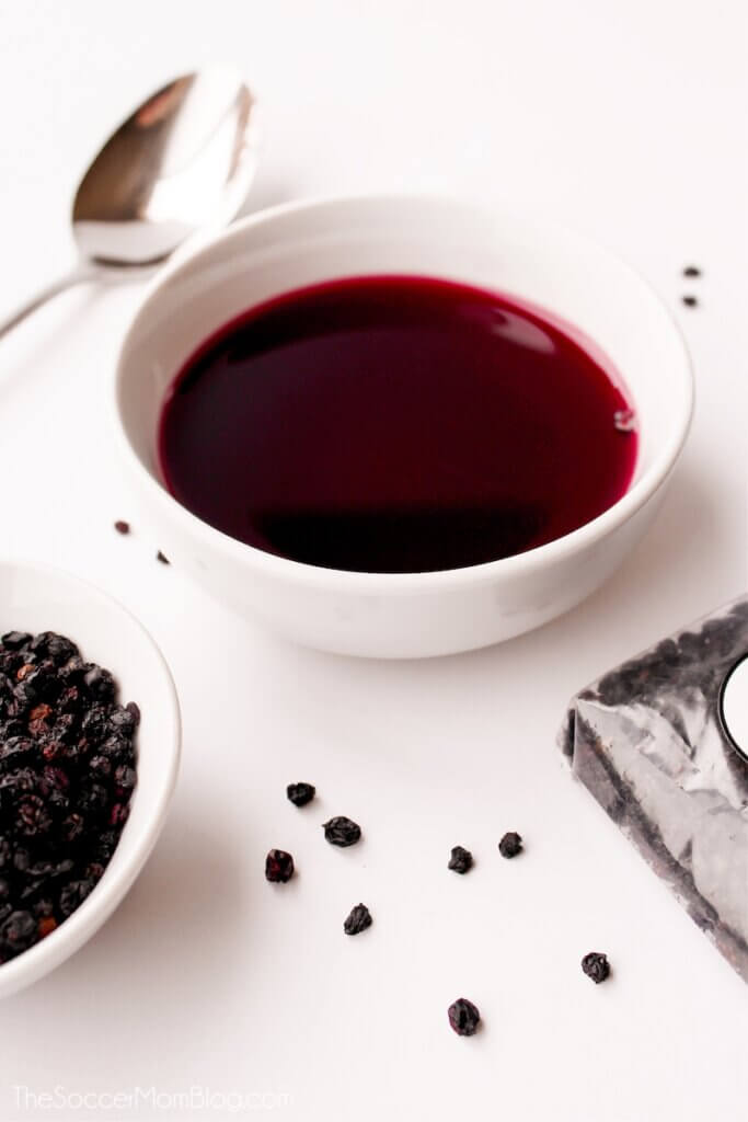 elderberry syrup in small bowl