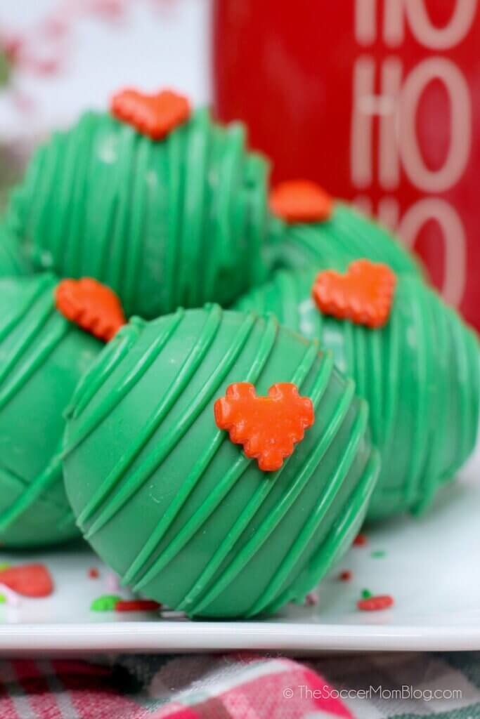 Festive green hot cocoa bombs inspired by the Grinch!