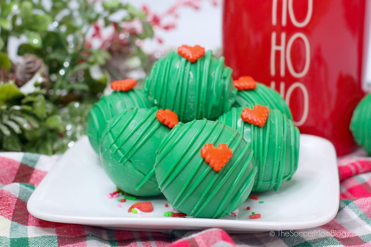 green hot cocoa bombs with red heart sprinkles