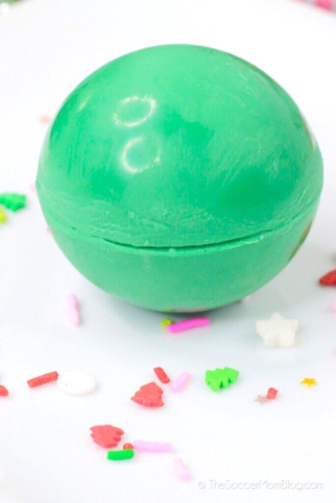 assembling spheres of green chocolate