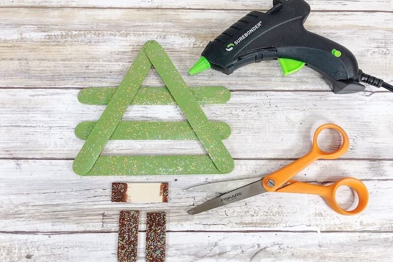 making a Christmas tree ornament with popsicle sticks