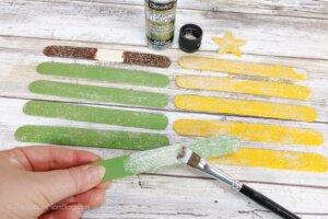 painting craft sticks with glitter glue