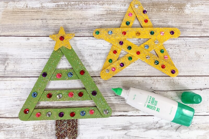 decorating popsicle stick Christmas ornaments with rhinestones