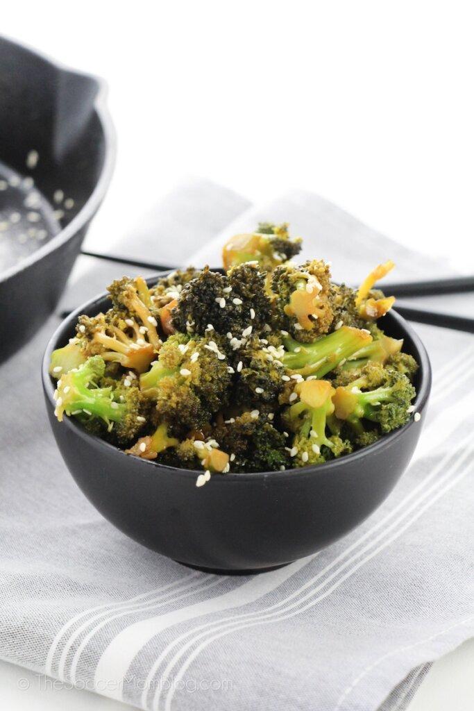 bowl of garlic broccoli and chopsticks