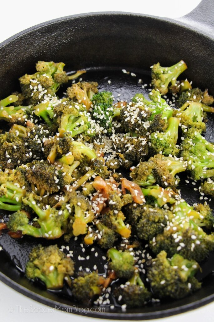 Broccoli with garlic sauce in iron skillet
