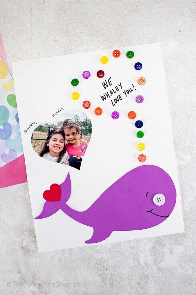 """kid made whale Valentine card with text """"We Whaley Love You"""""""