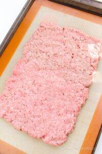 ground beef on baking sheet