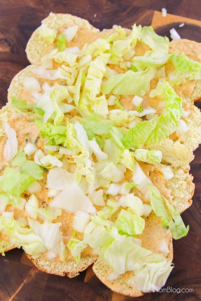 slider buns layered with Bic Mac sauce, shredded lettuce and onions