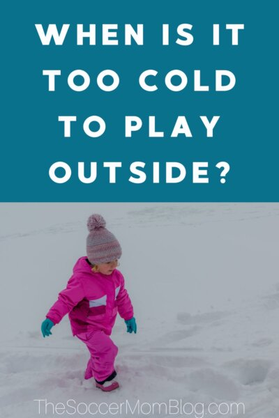 "little girl in snow in pink snowsuit; text overlay ""When is it too cold to play outside?"""