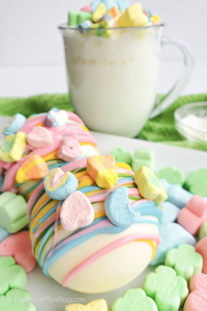 white chocolate hot cocoa bombs decorated with Lucky Charms marshmallows