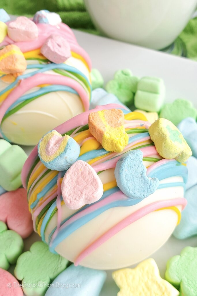 Lucky Charms Hot Cocoa Bombs topped with marshmallows