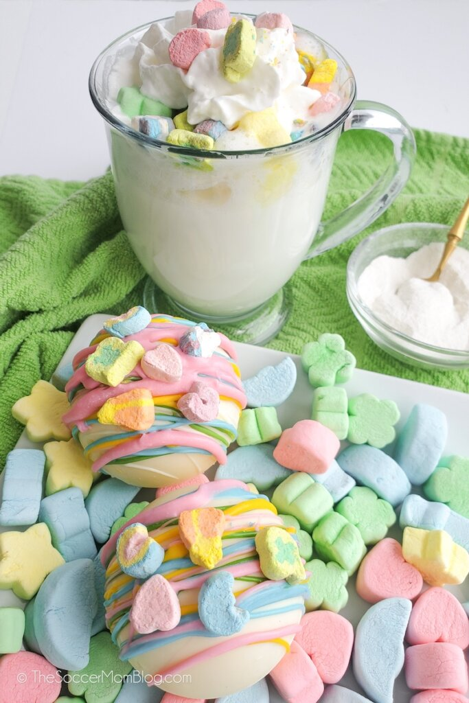 Lucky Charms Hot Chocolate Bombs and a mug of cocoa
