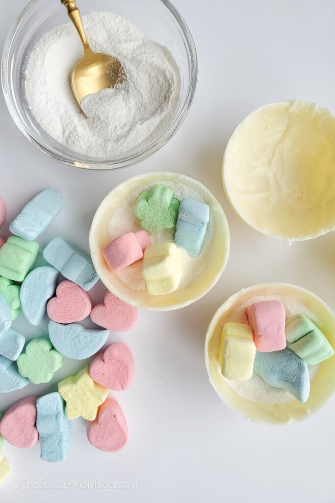 filling white hot chocolate bombs with Lucky Charms marshmallows