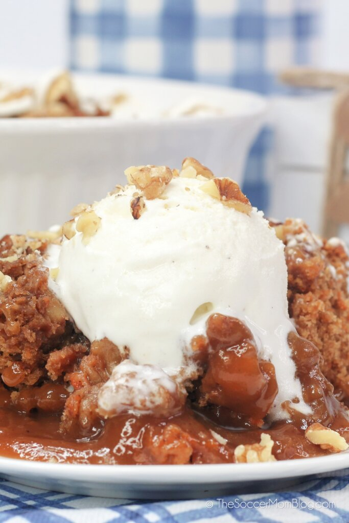 ooey-gooey carrot cake cobbler topped with caramel and ice cream