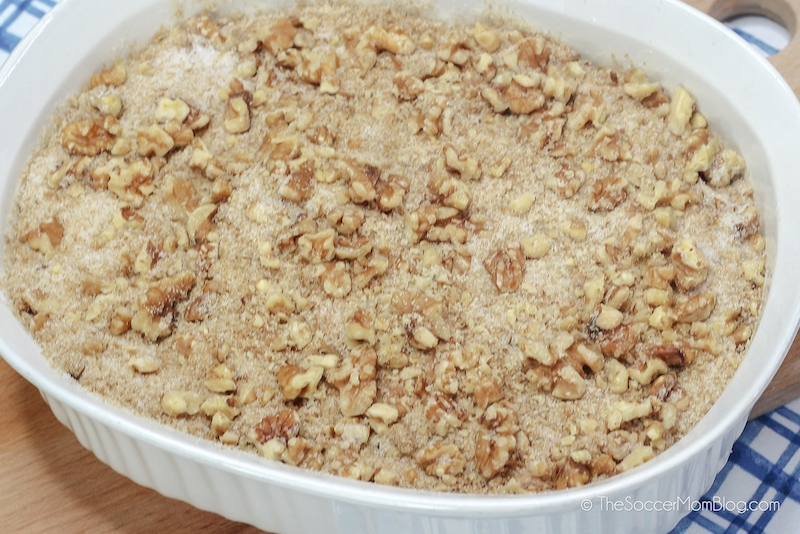 walnut crumble on top of cake batter in baking dish