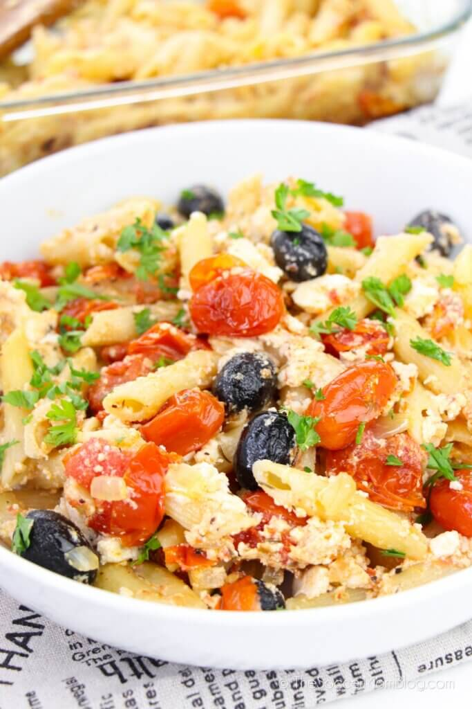 bowl of baked feta pasta with cherry tomatoes and olives, made famous on TikTok