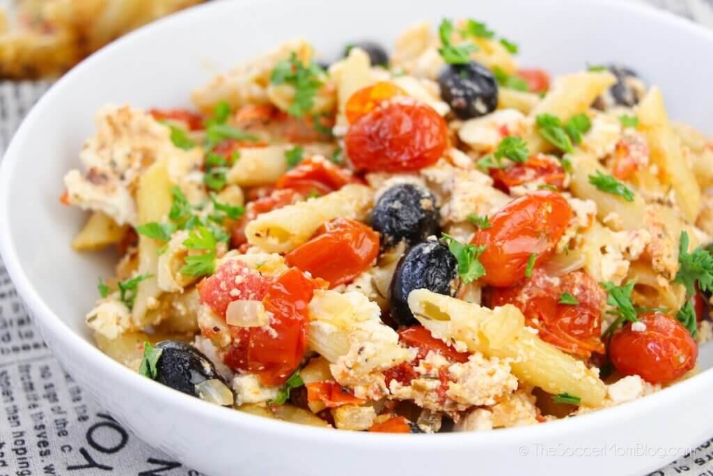 bowl of penne pasta with feta cheese and tomatoes