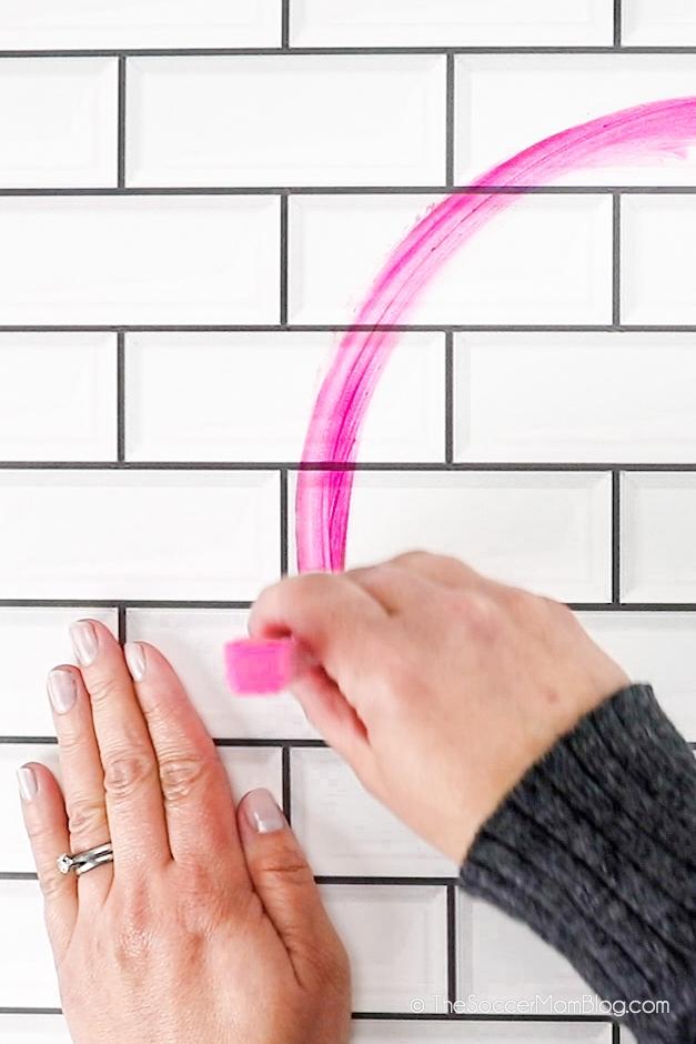 drawing on tile wall with bath crayon