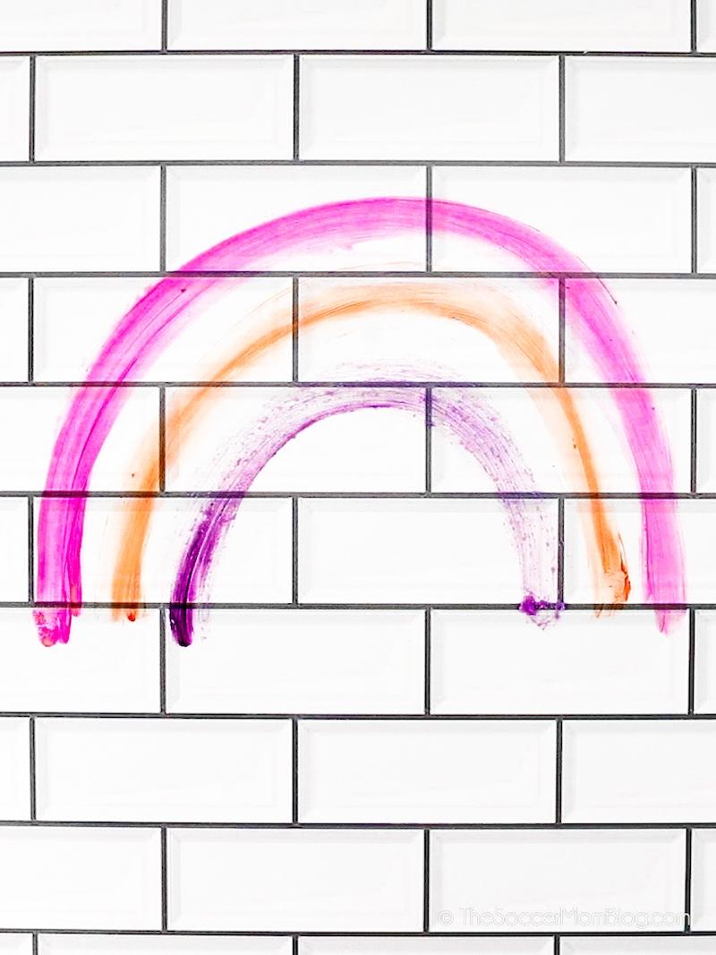 crayon rainbow on tile wall