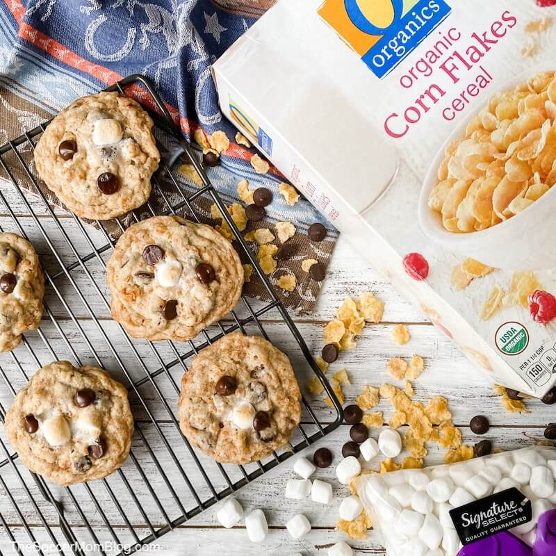 chocolate chip cookies on wire rack with box of cornflakes and marshmallows