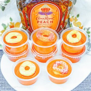 peach jello shots made with Crown Royal and peach rings candy