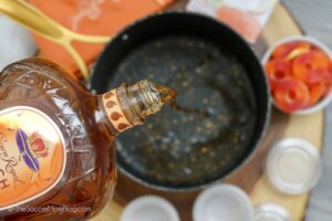 pouring Crown Royal into saucepan