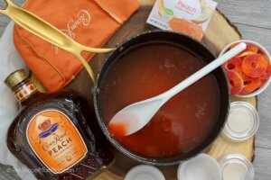 mixing peach Jello in saucepan