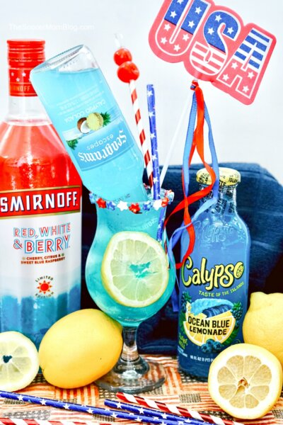 bright blue electric lemonade cocktail with patriotic decorations