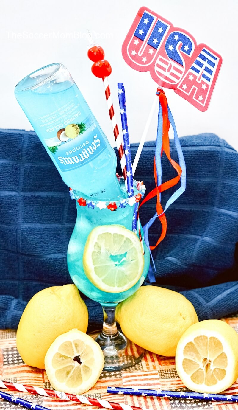 hurricane glass with electric blue lemonade and USA decorations