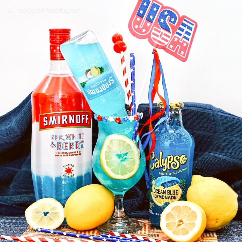 hurricane glass with blue lemonade and patriotic decorations
