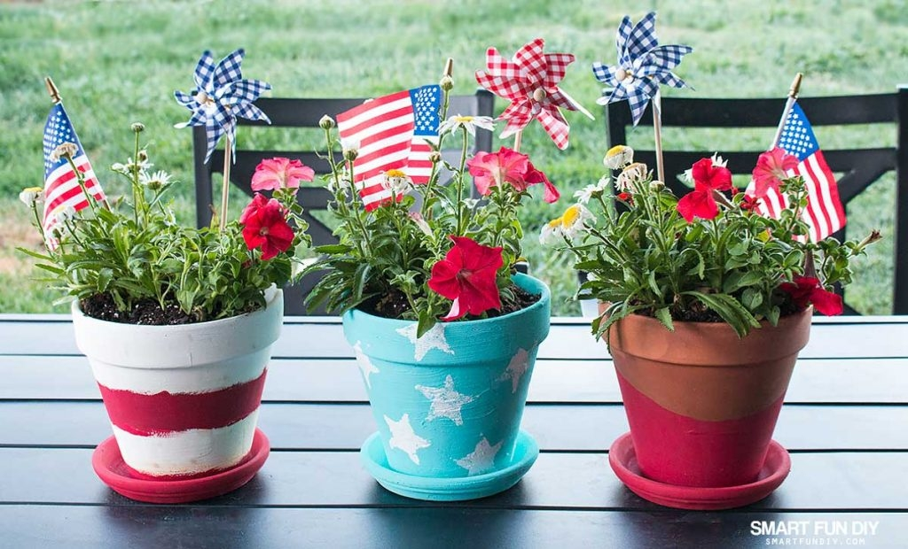 red white and blue painted flower pots