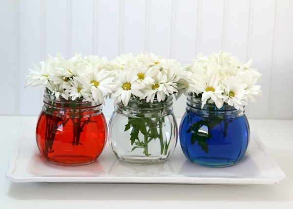 flower jars with red white and blue water as a centerpiece