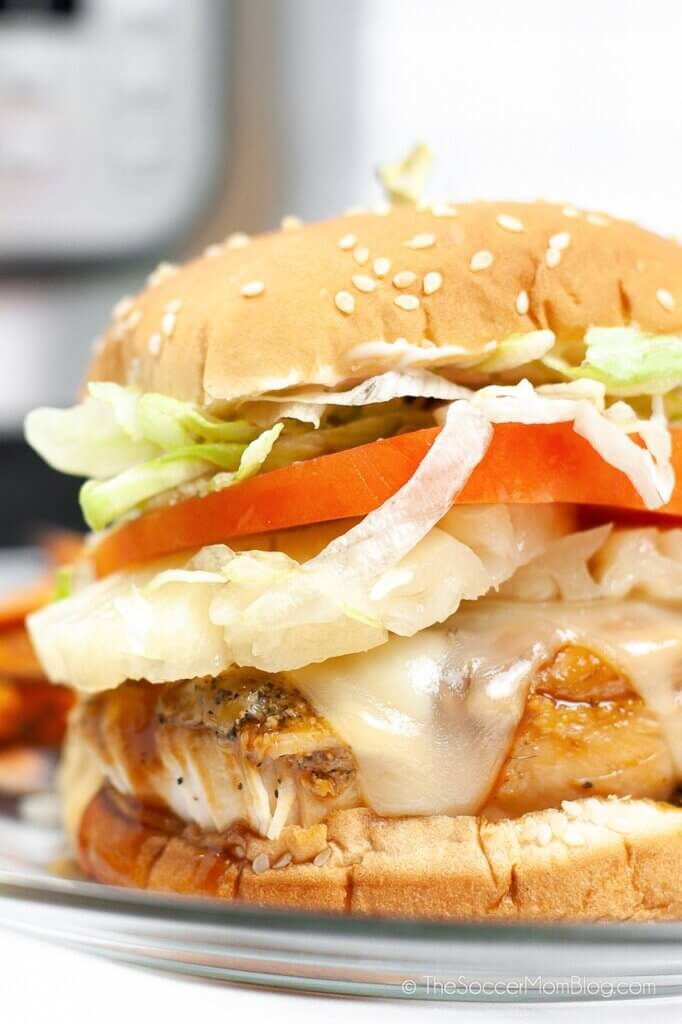 close up of a juicy teriyaki chicken burger with cheese