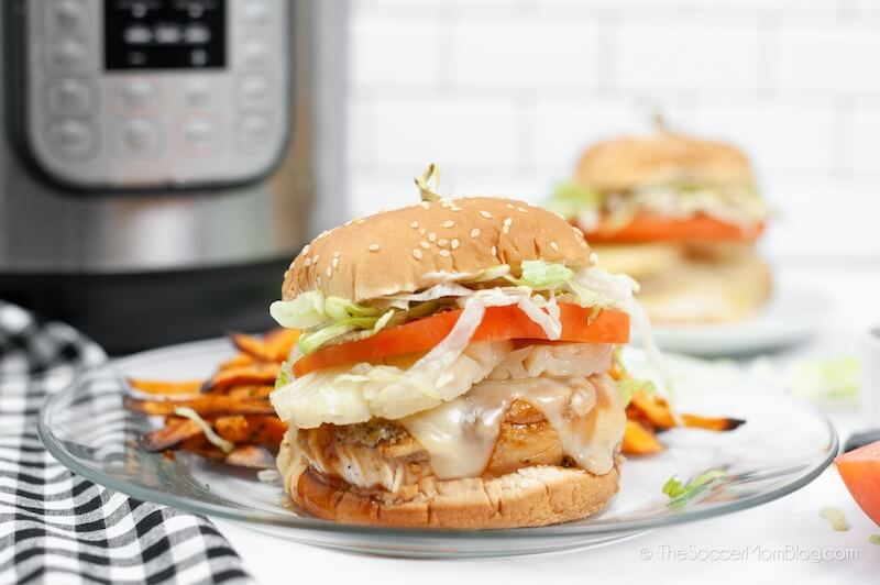 chicken teriyaki burger with cheese, lettuce, pineapple, and tomato