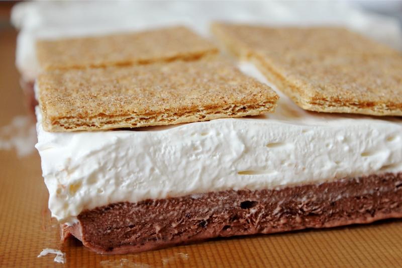 making layered frozen smores dessert
