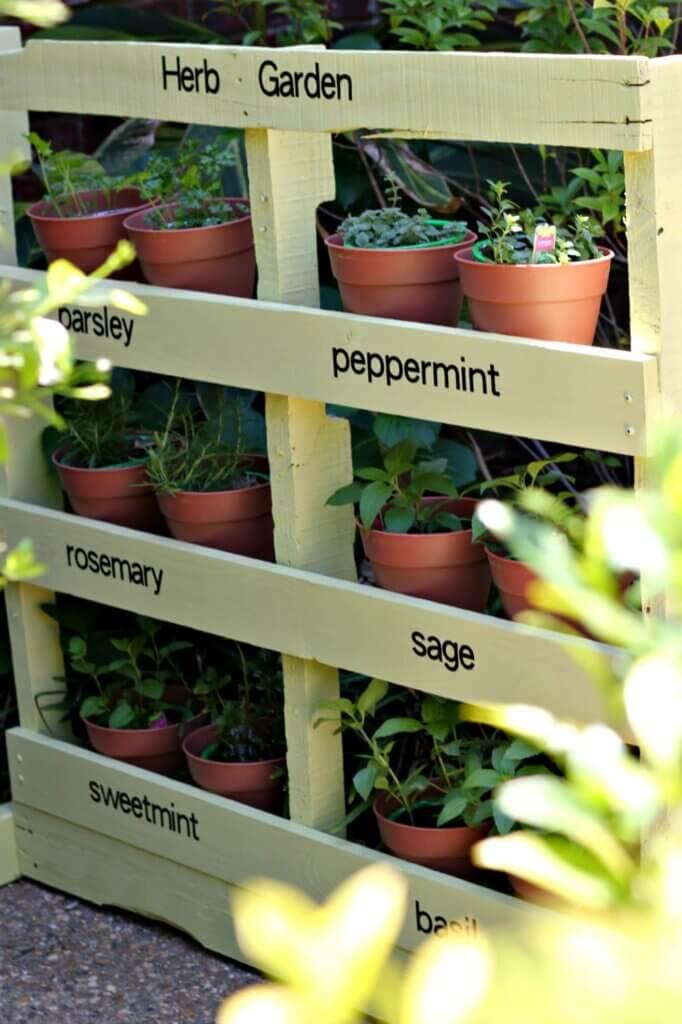 herb garden shelf made using a painted wooden pallet