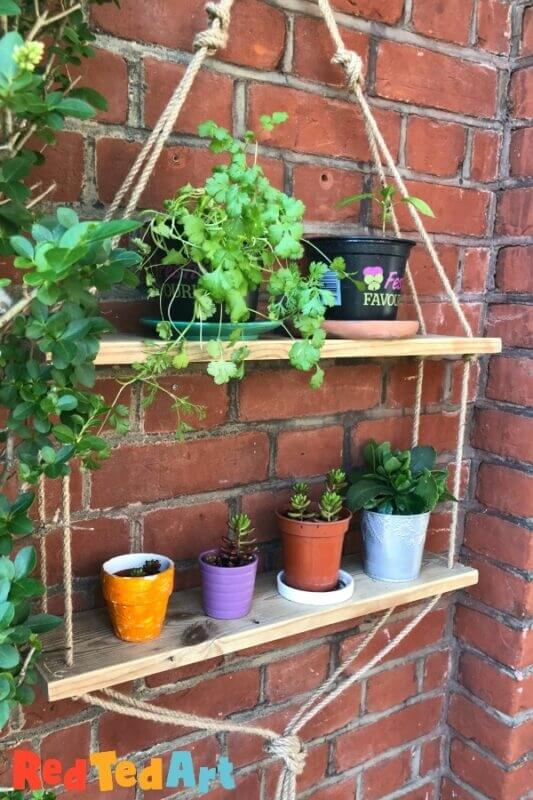 hanging garden shelves made with scrap wood