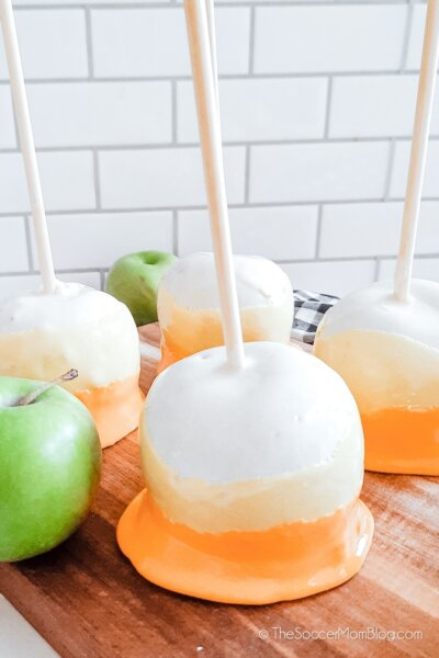 candy apples decorated to look like candy corn