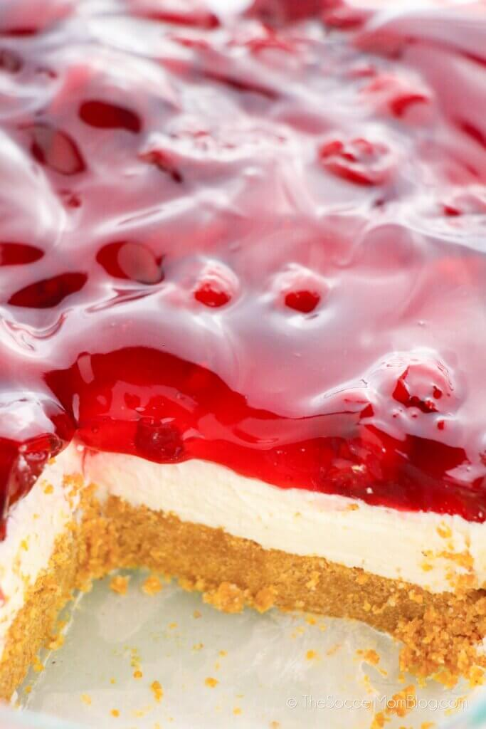 Pan of no bake cherry cheesecake with piece missing