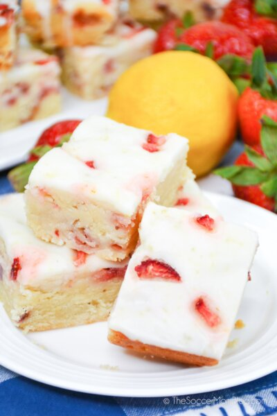 Strawberry Lemon Bars stacked decoratively on a plate
