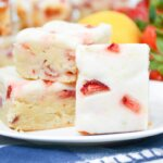 Strawberry Lemon Bars stacked on a plate for display
