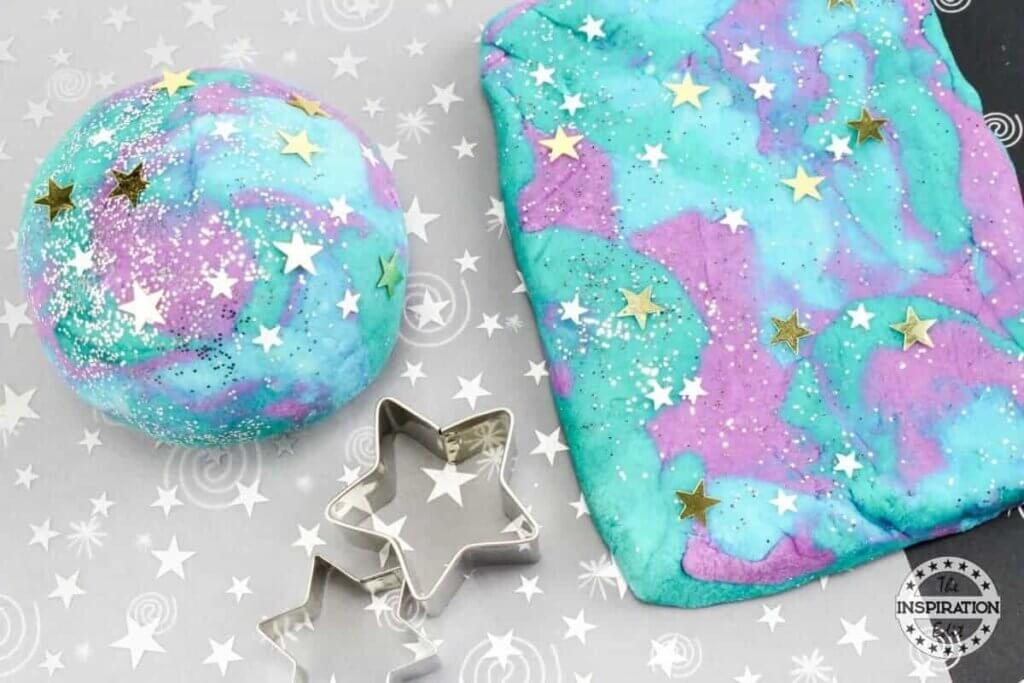 purple and blue play dough with glitter
